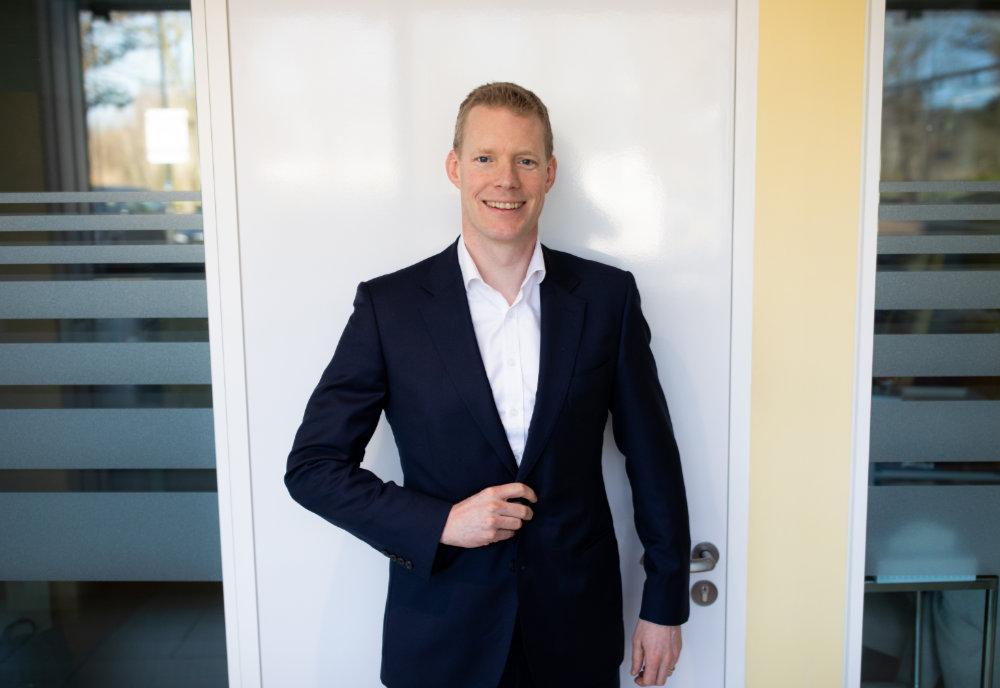Simon Rogers suit doorway
